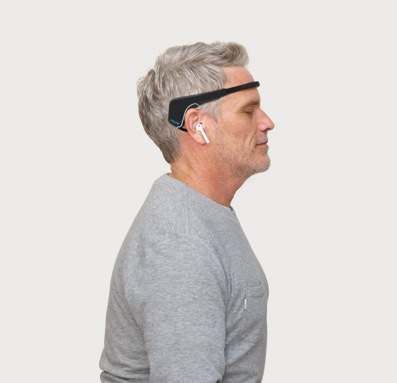 A man wearing grey shirt using the Muse 2.