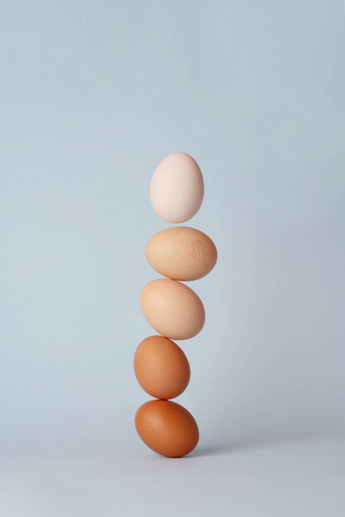 Stack of brown eggs.