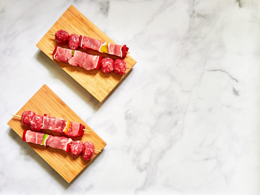 Assortment of red meat on a skewer on a table. Is red meat bad for you?