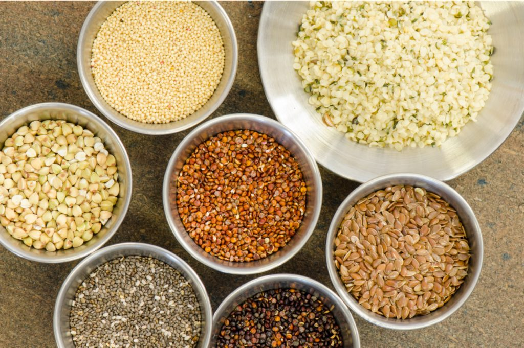 Ancient grains in aluminum bowls.