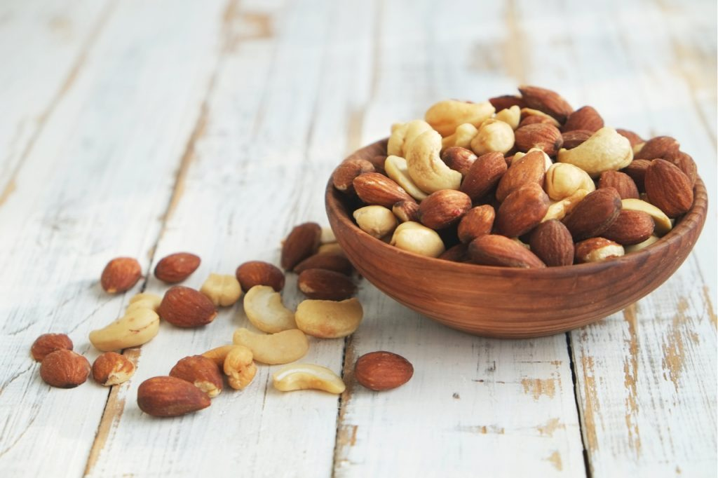 Mixed nuts in a wooden bowl.