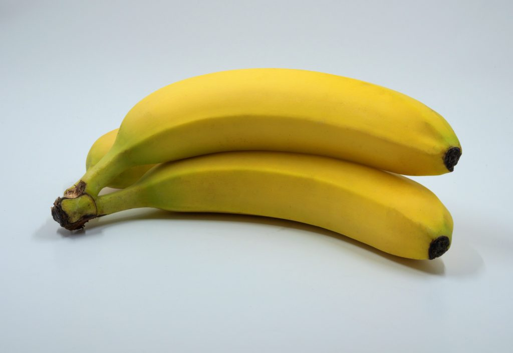 Three pieces of ripe banana on white background.