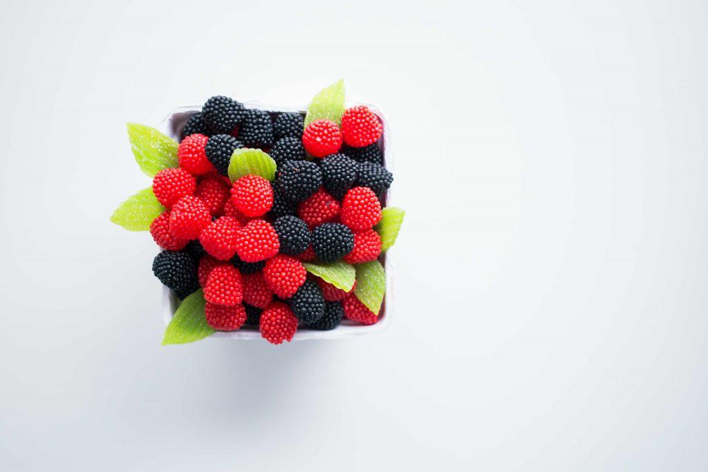 Cup of blackberries and raspberries.