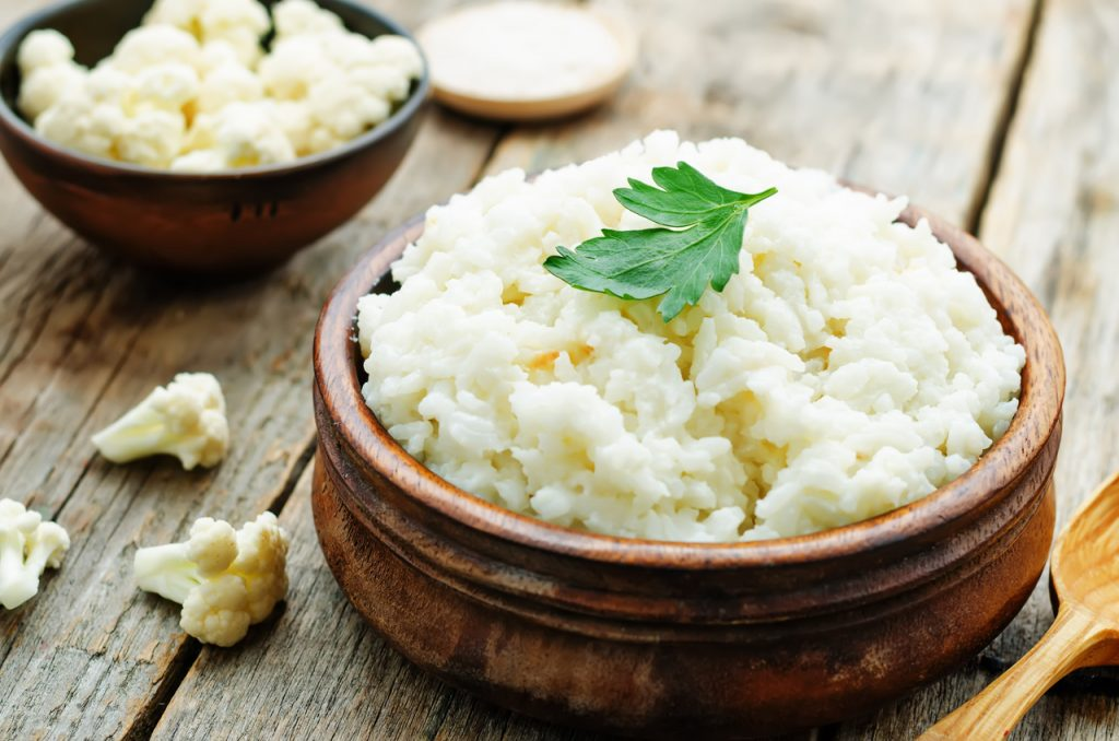 A bowl of cauliflower rice perfect for a lower calorie food alternative.