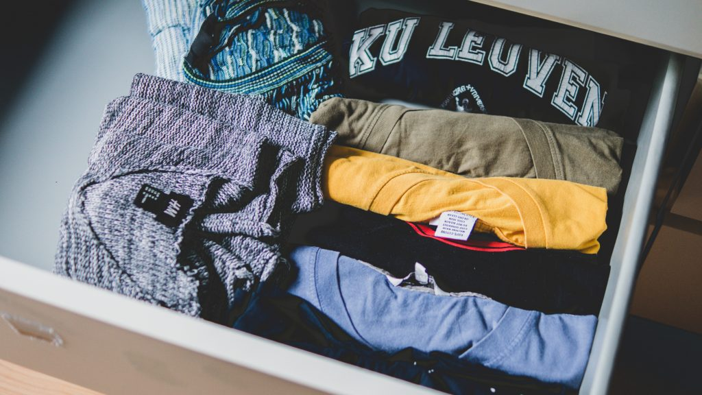 Close up of clothes folded in a draw.