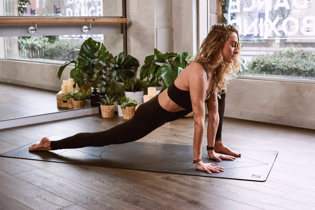 Fit woman stretching on a yoga mat.