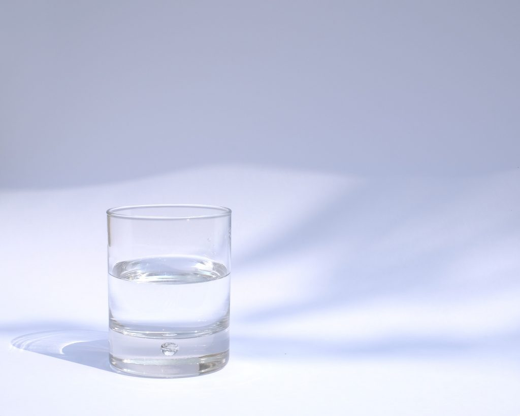 Glass of water to keep you hydrated as part of your muscle recovery foods.