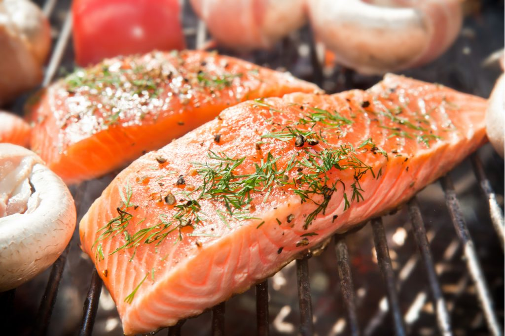 Salmon fillet on a barbecue grill is an example of protein.