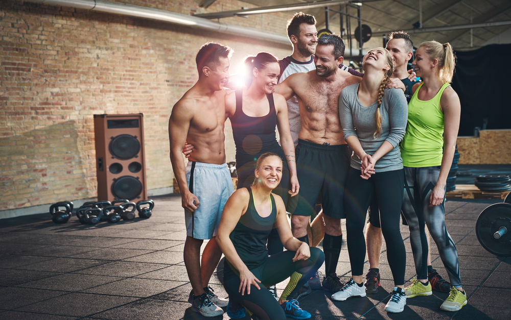 A group of friends having fun preparing for workout. Overcome your barriers on how to make friends.