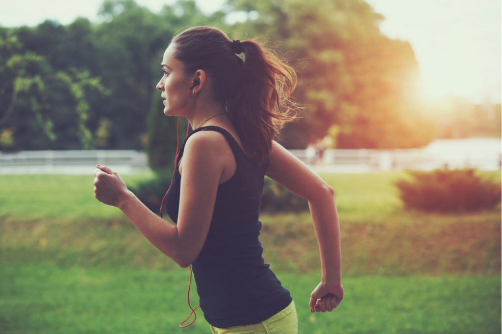 Woman jogging solo in the park.