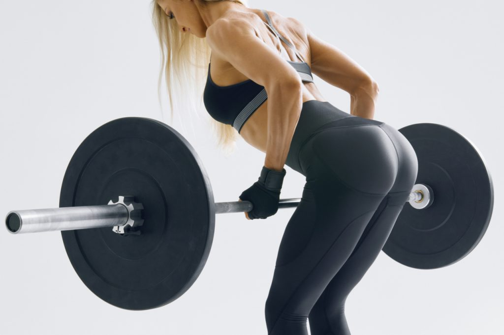 Fit woman doing deadlift. Deadlift a popular lower body lifts but not one of the most ideal exercises for the butt.