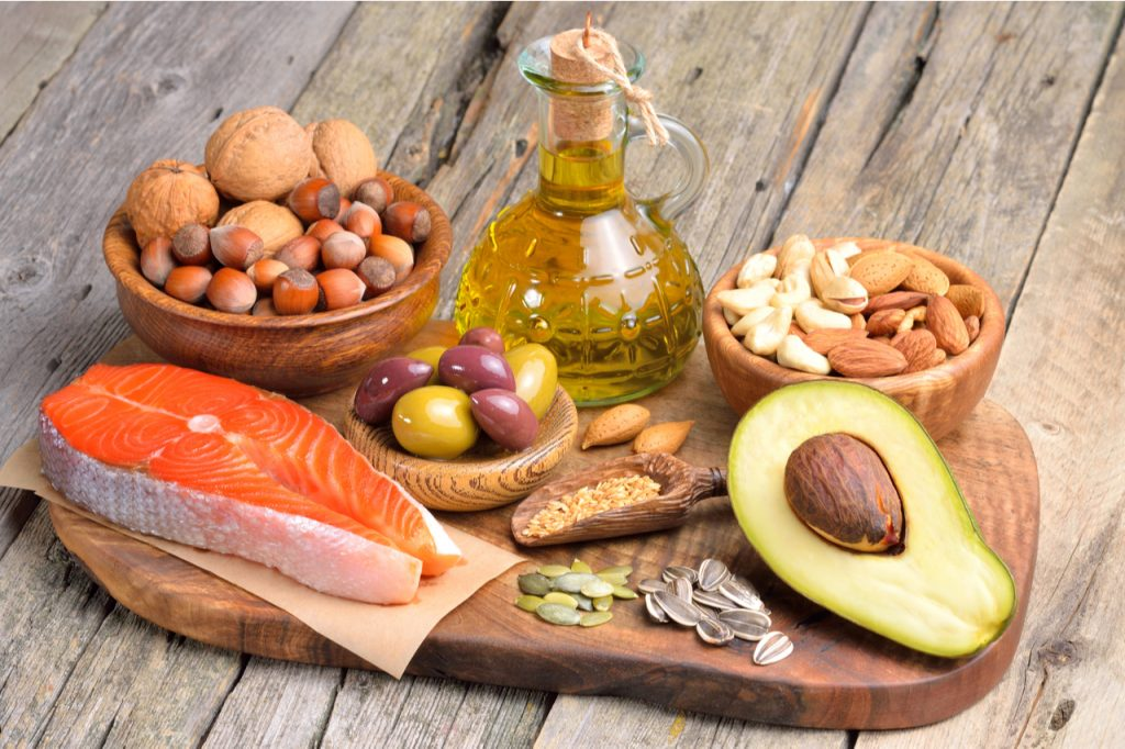 Salmon, avocado, and some nuts as healthy fat food sources.