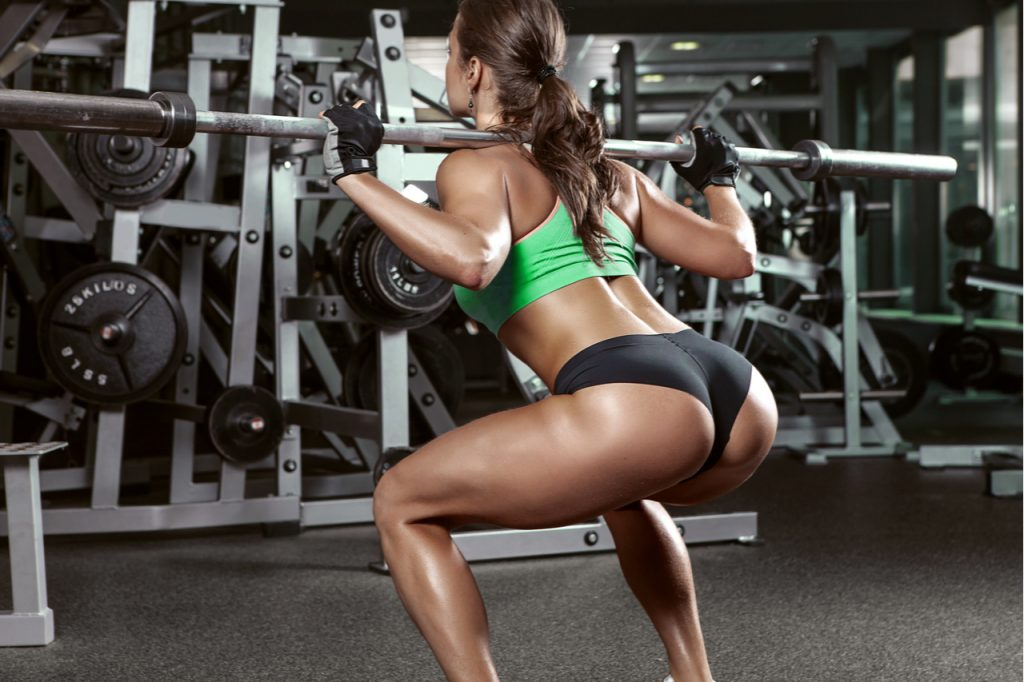 Woman doing some weighted squats.