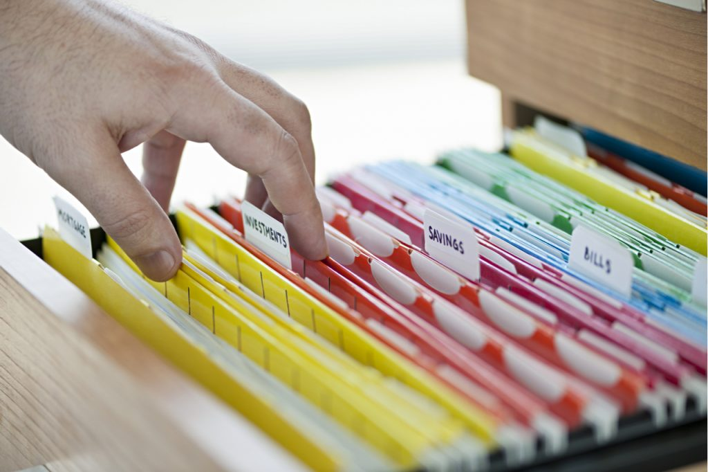 A well organized drawer with tab labels in each folders.