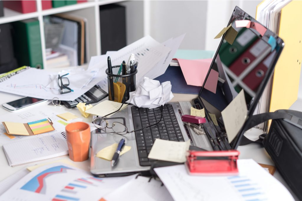 An image of a messy office desk that needs an organized office desk ideas.