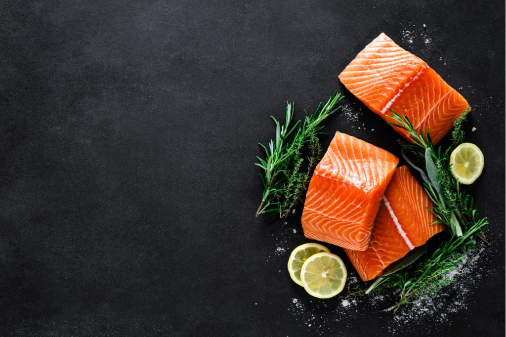 Salmon slices in a black background.