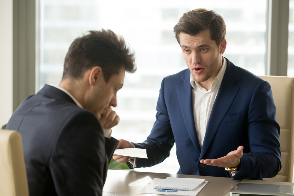 Angry boss yelling at employee. Know how to have a healthy work-life balance to be productive at work.