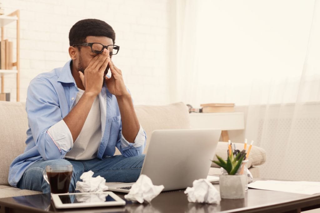 A man having a headache due to stress