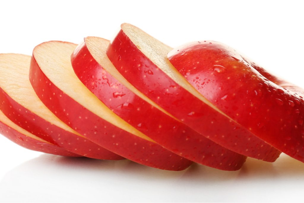 Closeup of apple slices, representing attractiveness.