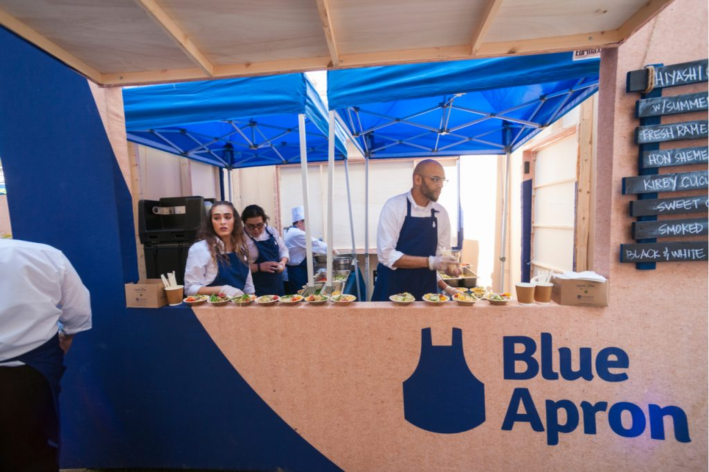 Blue Apron booth offering food.