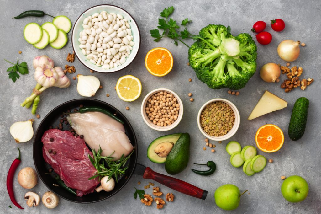 Selection of fruits, vegetables, meat and nuts.