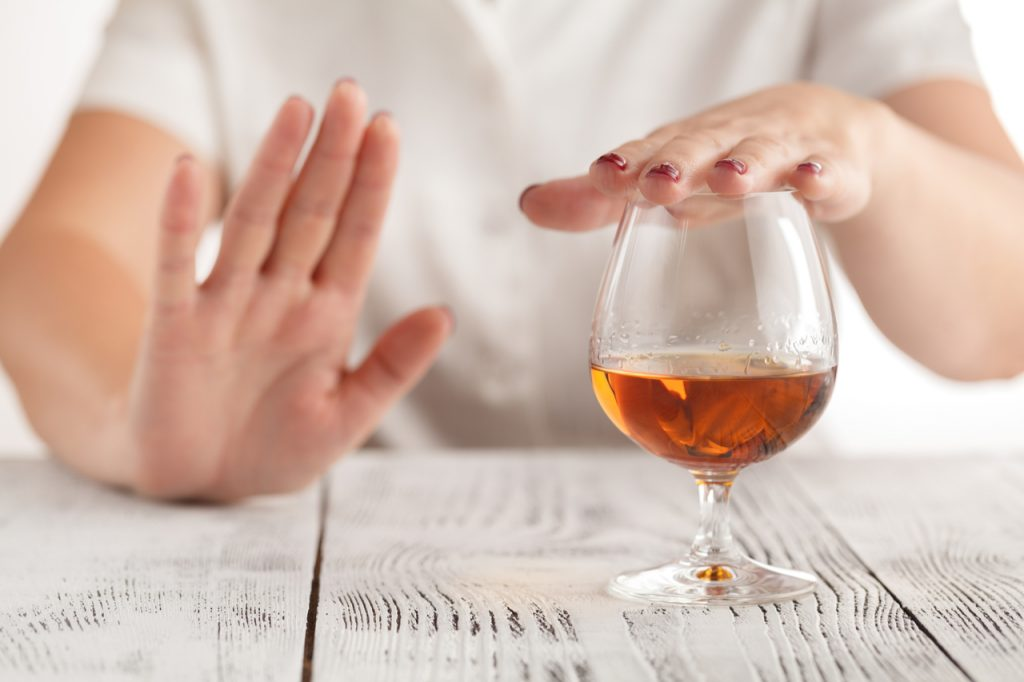 A woman saying no to alcohol drinking