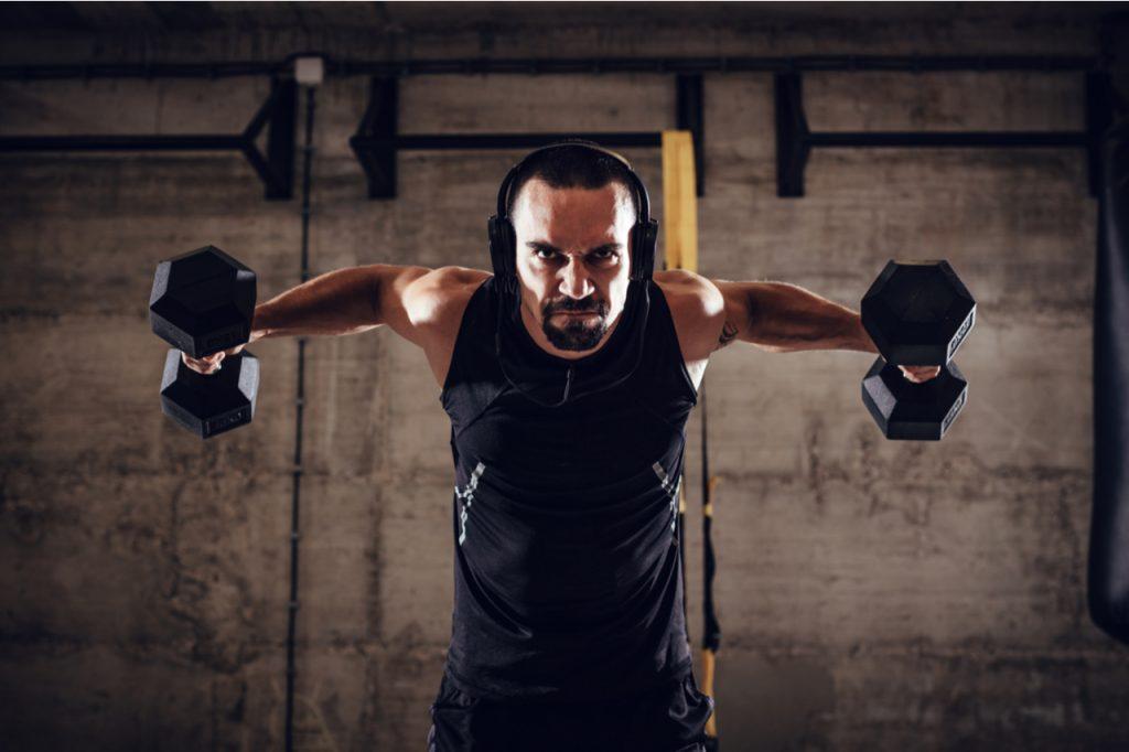 A man doing an arm dumbbell workout.