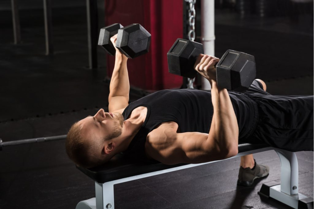 A man doing a dumbbell workout for the back