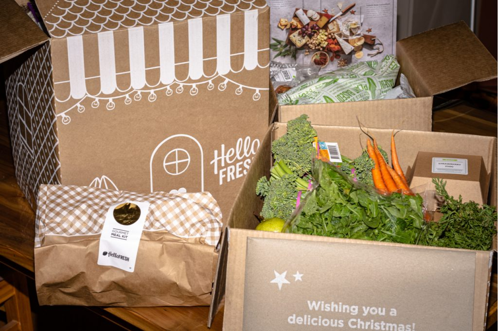 Meal kit delivery services from HelloFresh, includes chicken, ham and sides with cheese platter, desert and fresh vegetables.