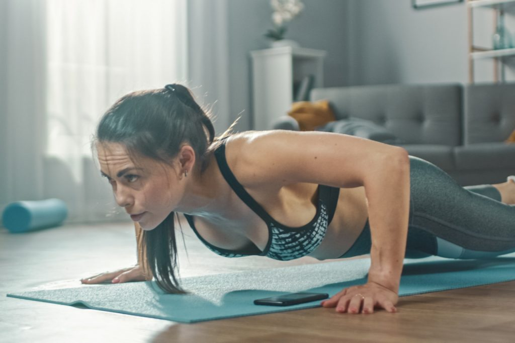 A woman exercising at home.