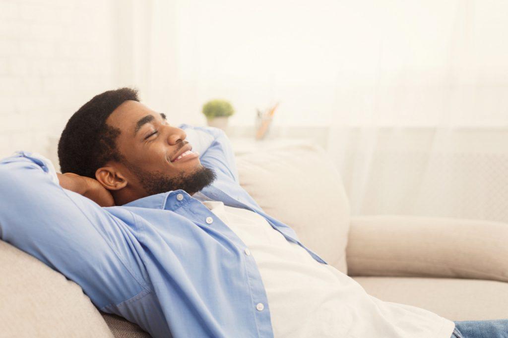 A man relaxing as part of positive attitude.
