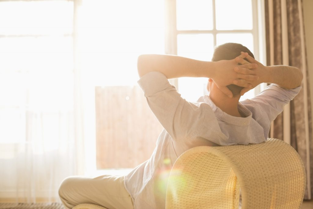 A man relaxing thinking about how to boost immune system.