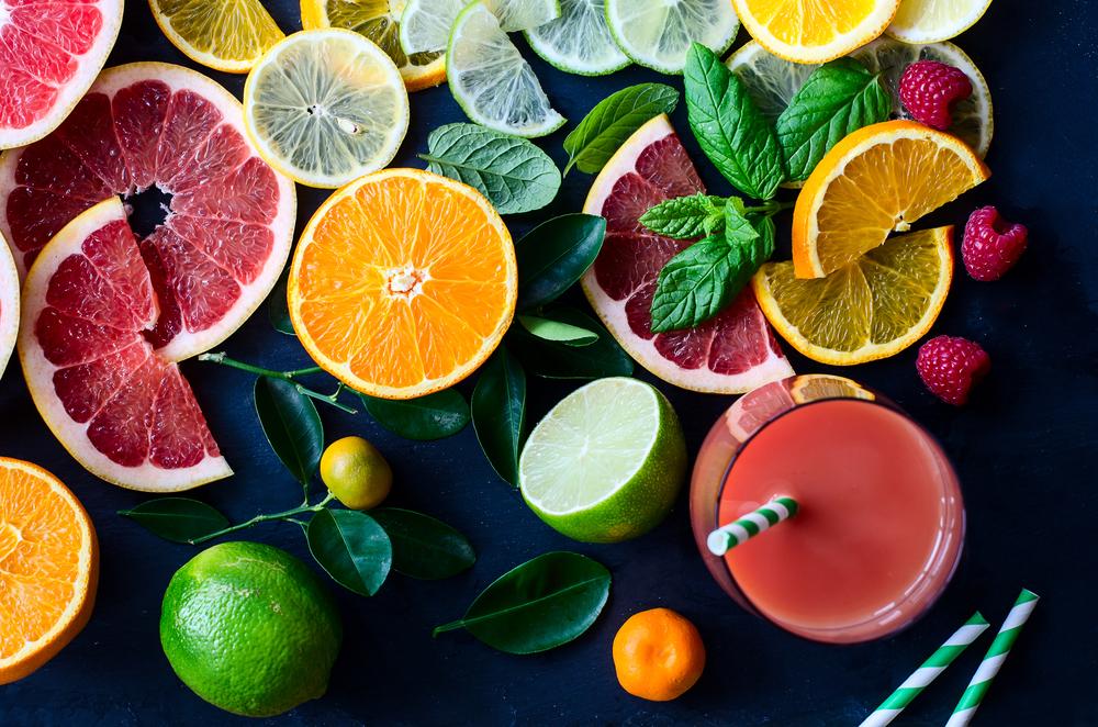 Citrus juice and slices of orange, grapefruit, lemon. Vitamin C