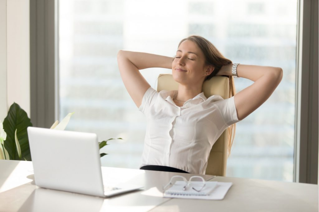 A woman taking a break and relaxing while working.