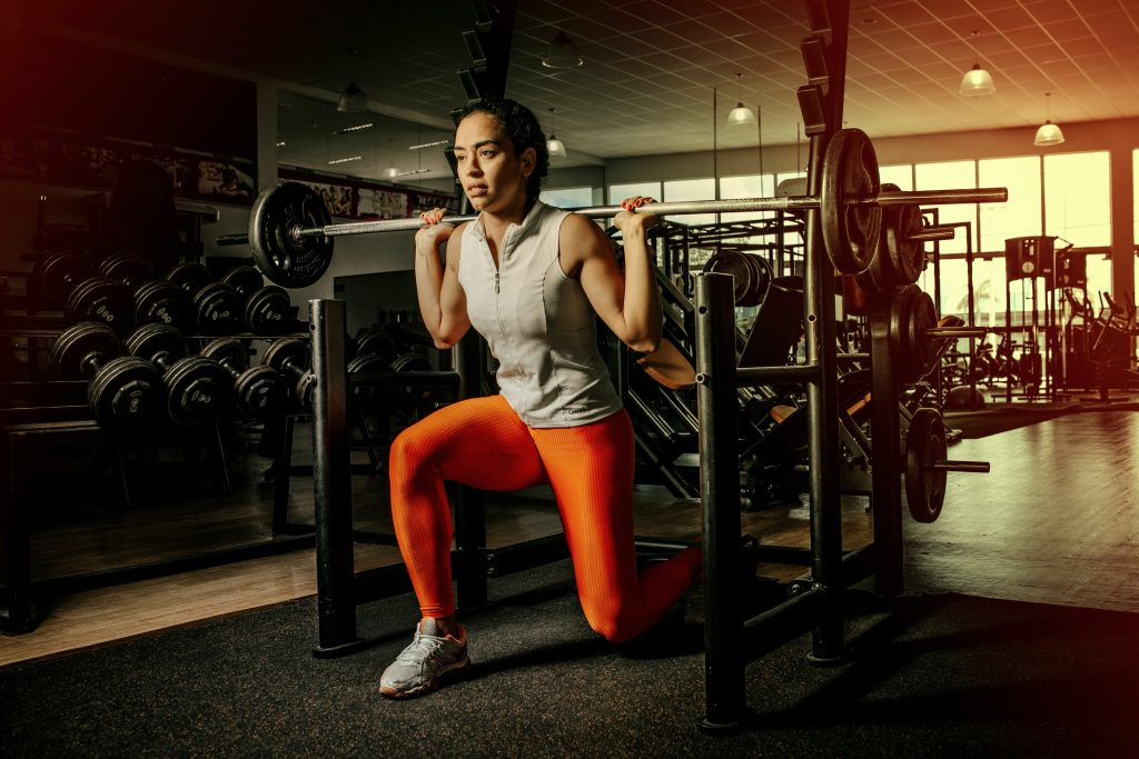 A woman weightlifting for thinner leaner stronger review