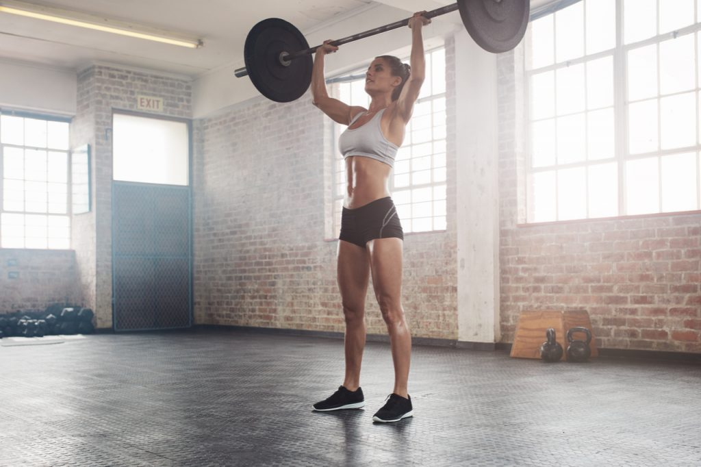 A woman doing weight lifting.
