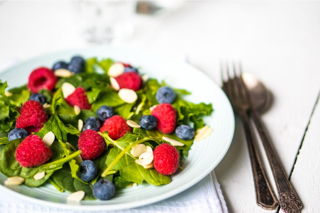 Green salad with berries and almonds.