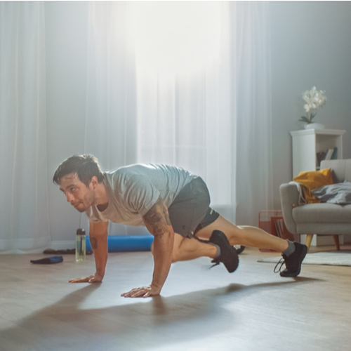 A man doing plank work outs at home.