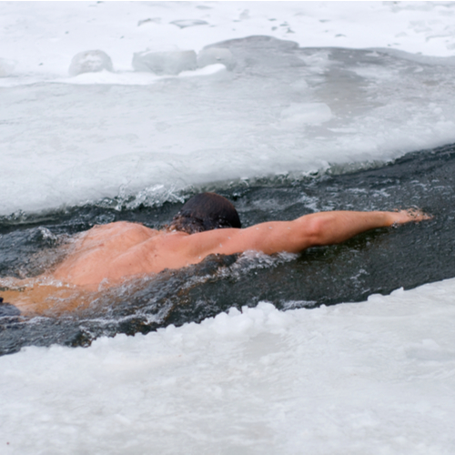 Winter swimmer in the unfrozen patch of water