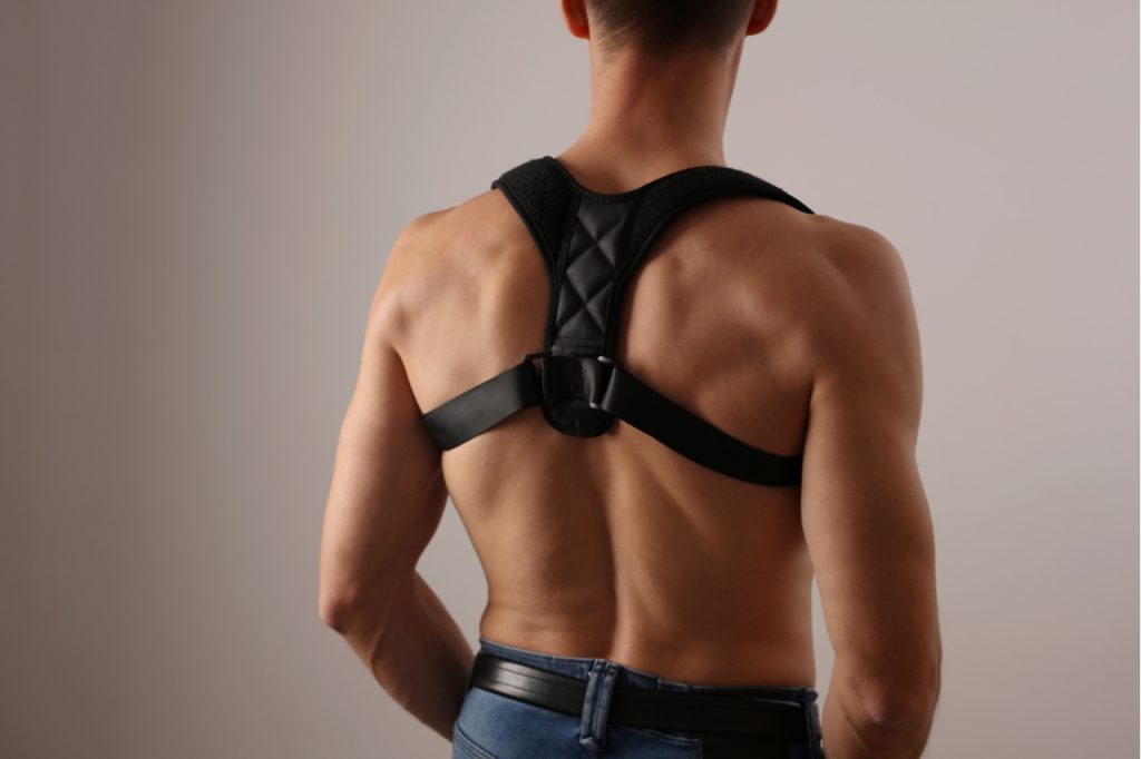 Man with posture corrector.