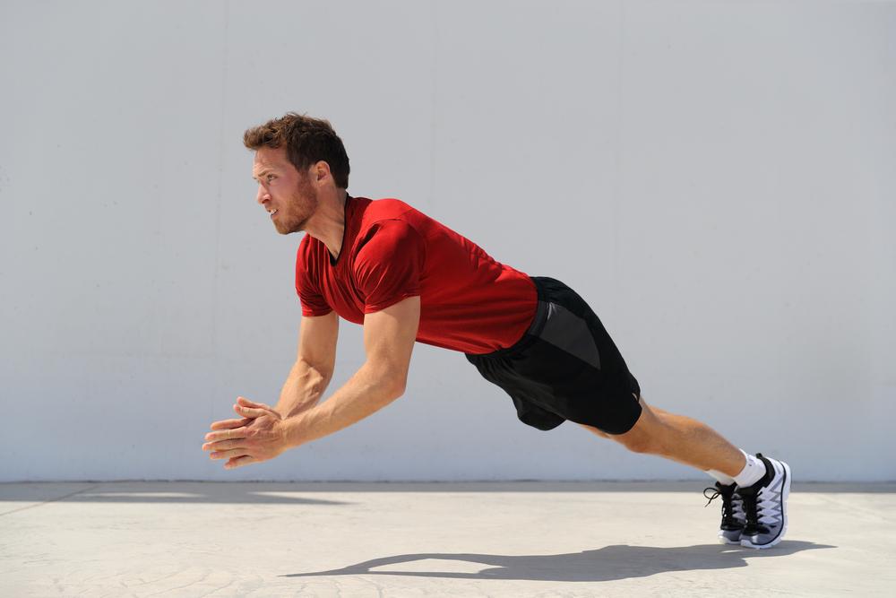 fitness man doing plyometrics push-up exercises explosive workout for muscles training.
