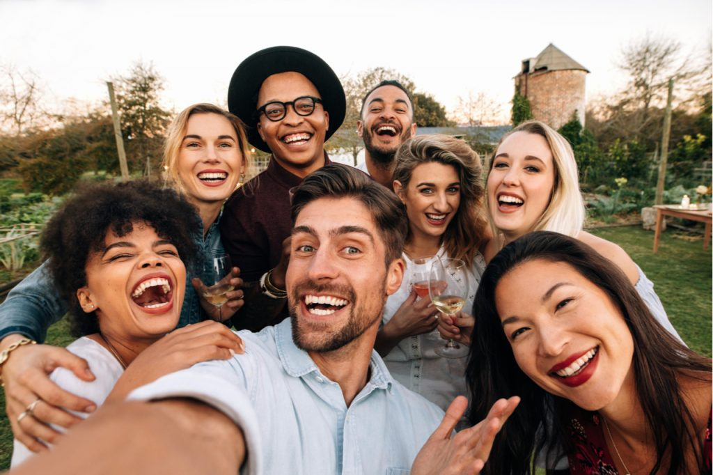 A groupfie of happy friends.