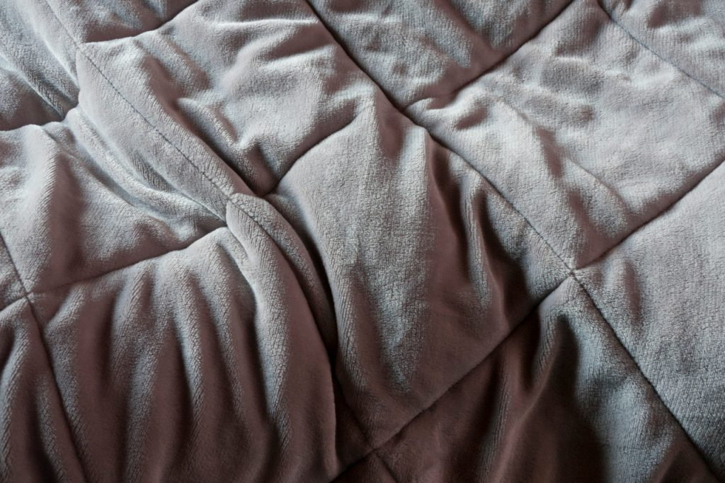 Grey weighted blanket. What is a weighted blanket?