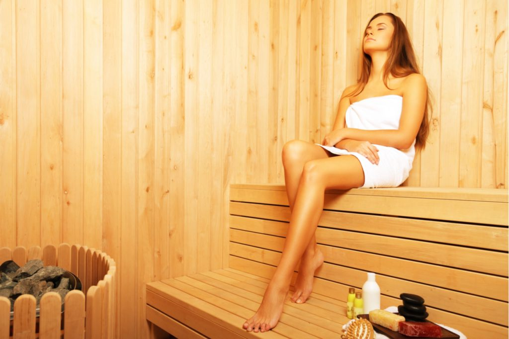 Woman Relaxing in the Sauna.