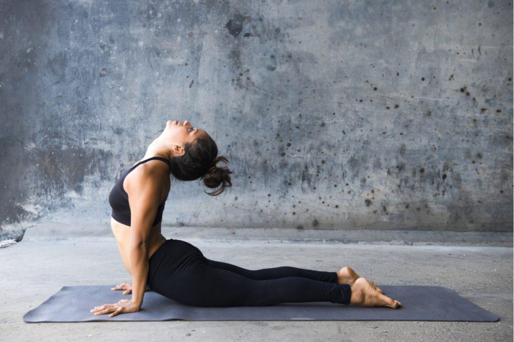A woman doing the Bhujangasana yoga pose.