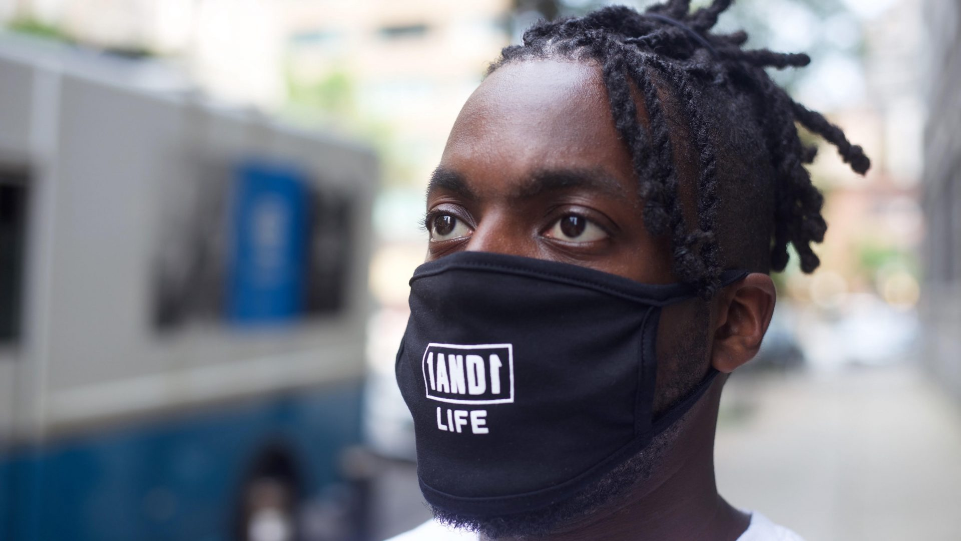 Model wearing 1AND1 Life reusable face mask