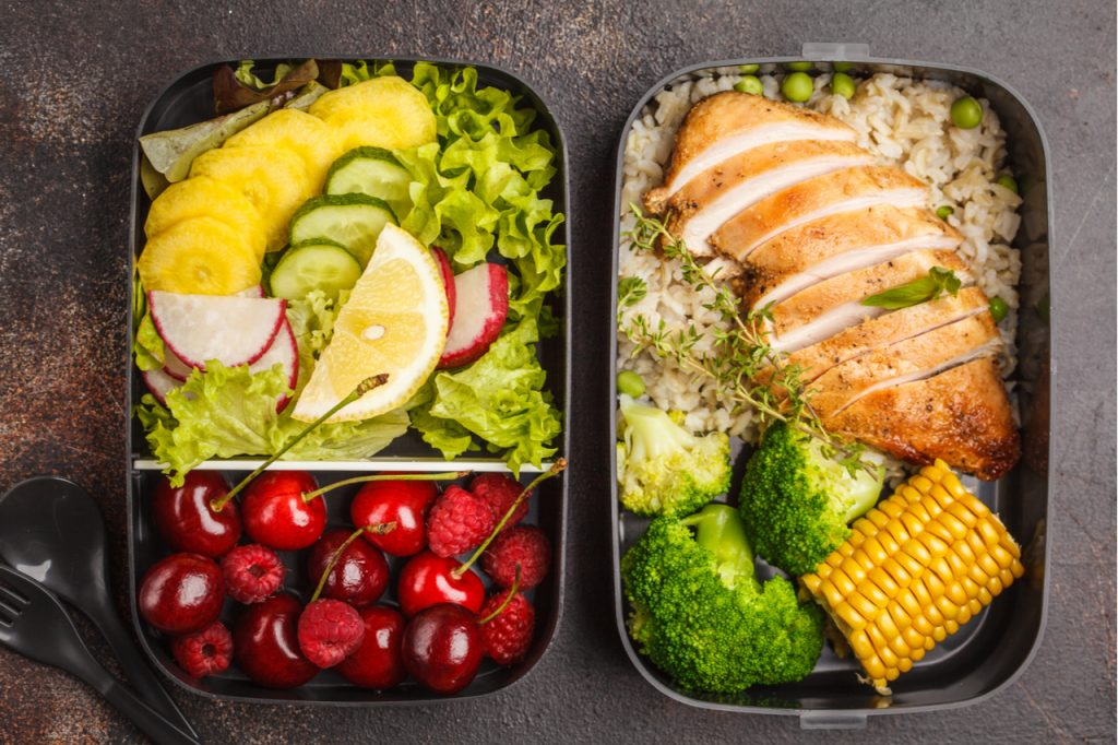 A healthy meal prepared in 2 containers to be eaten before and after workout.