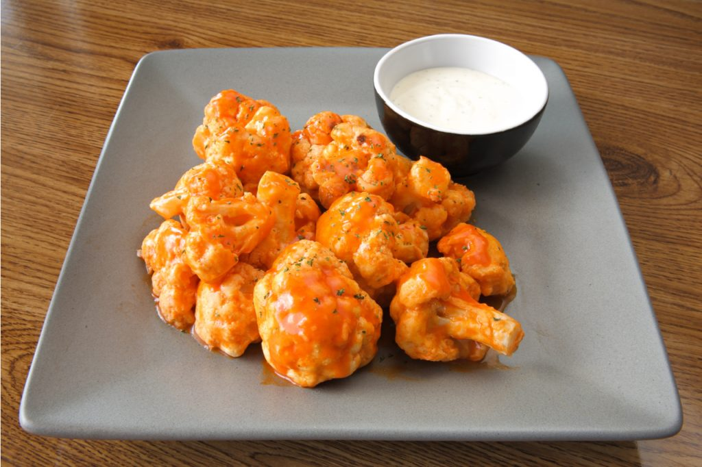 Buffalo-style cauliflower dish with ranch sauce as part of the new BBQ recipes.