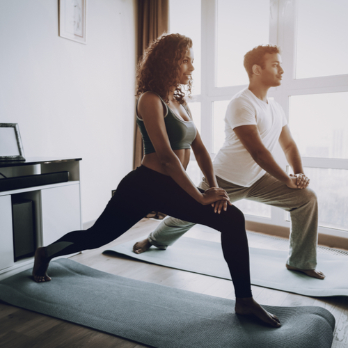 Couple doing morning exercise at home.
