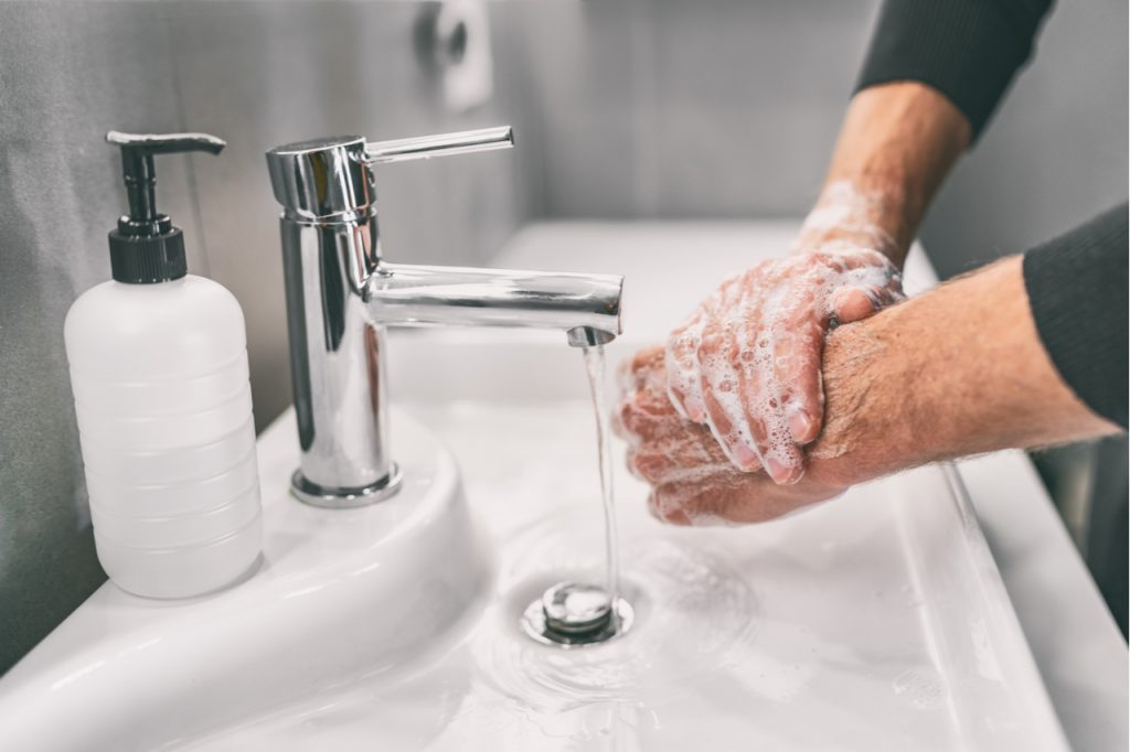 Washing hands rubbing with soap man for corona virus prevention.